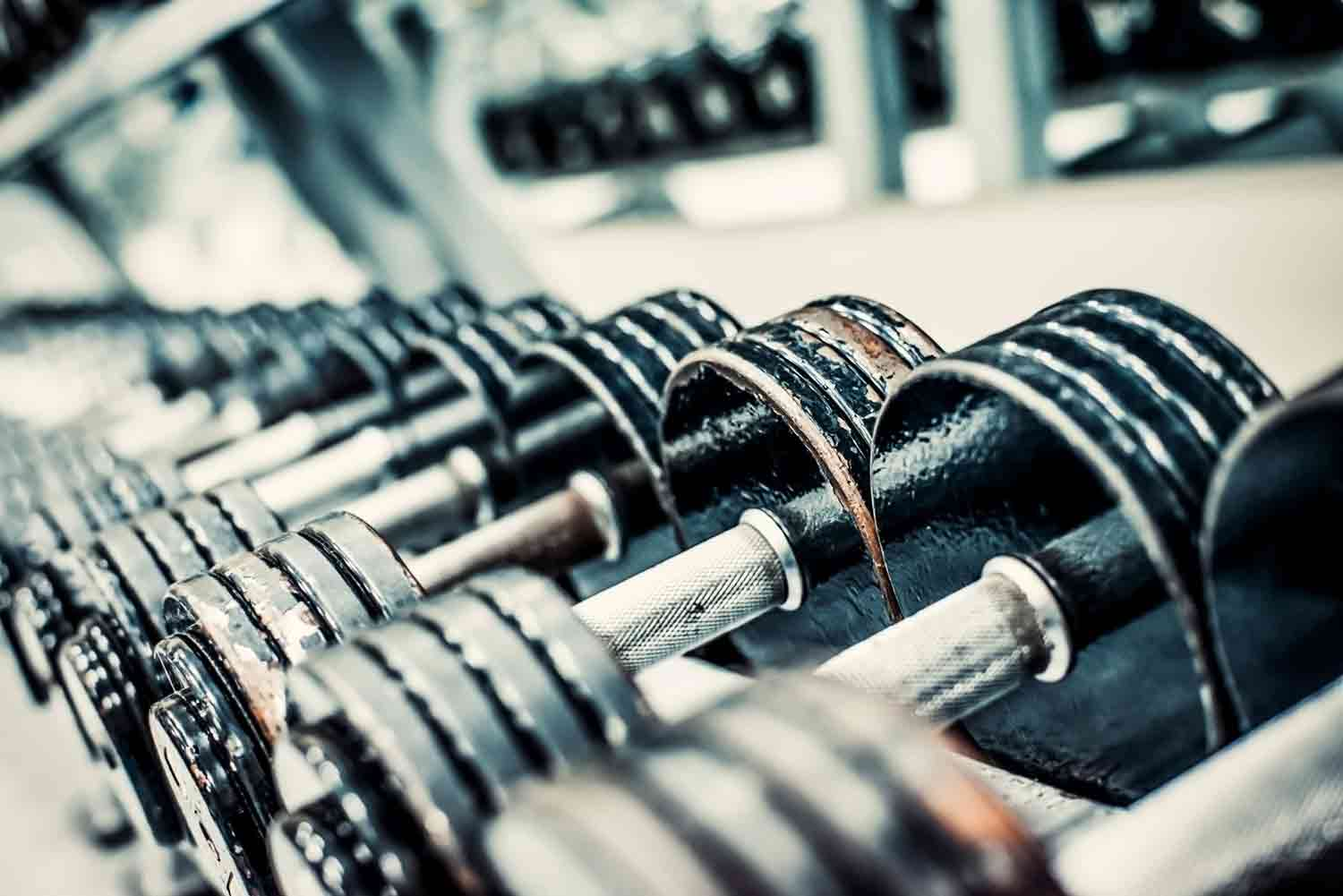 Sports dumbbells in modern sports club. Weight Training Equipmen
