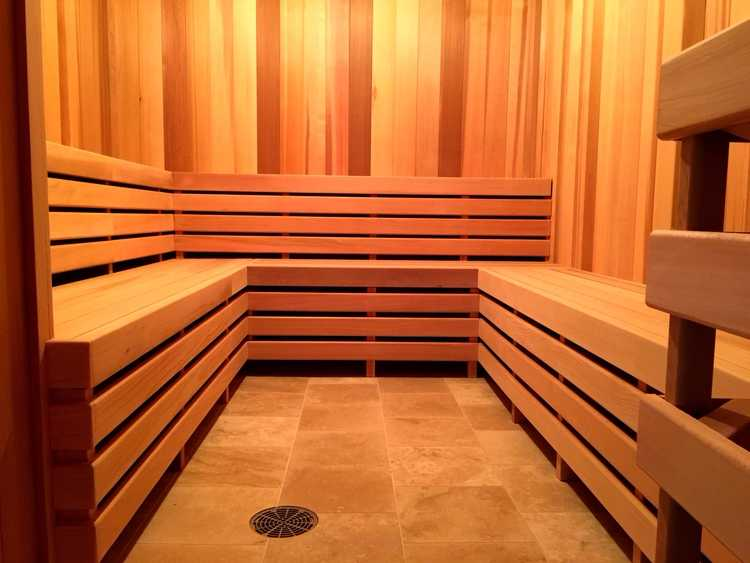 Image of a sauna capturing the symmetry of the wooden benches.