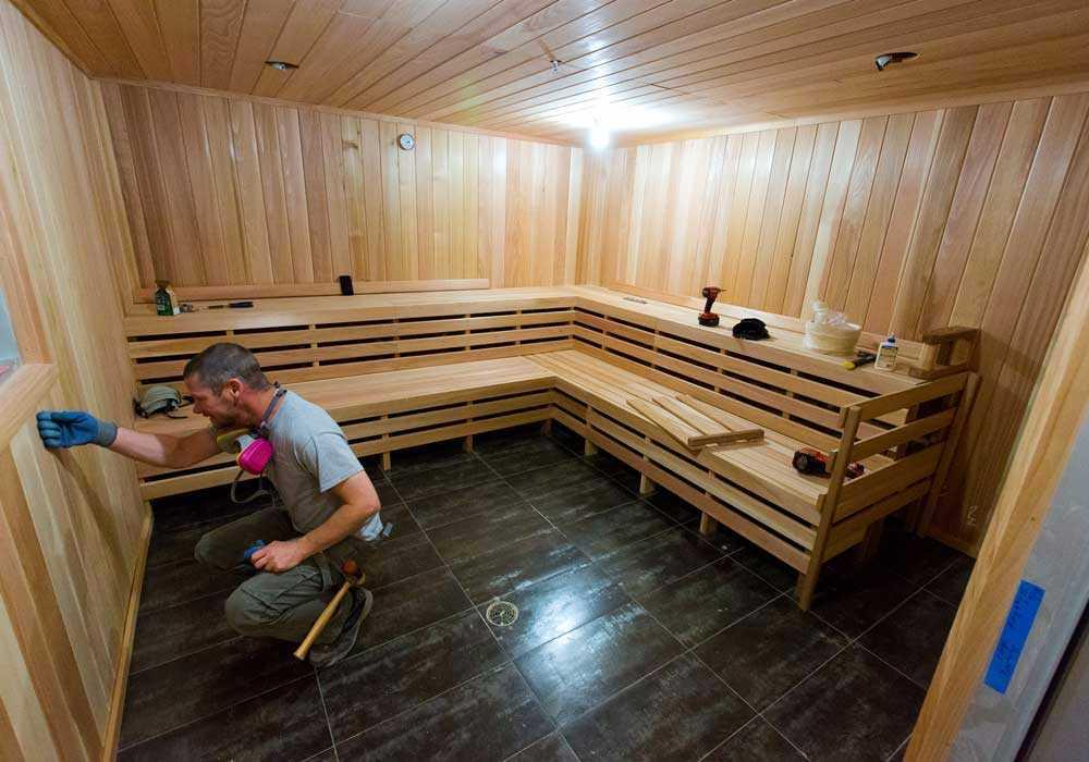 welder fusing materials together in a sauna heater