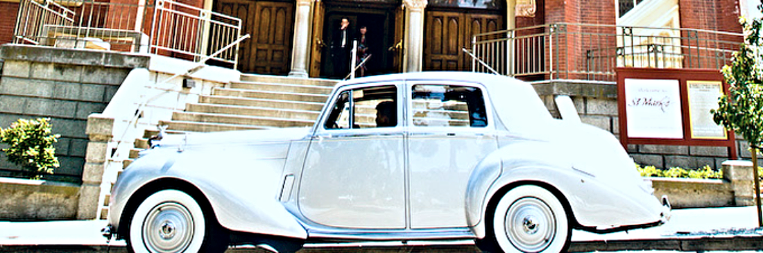 The honeymoon getaway car parked outside St. Mark's Lutheran Church