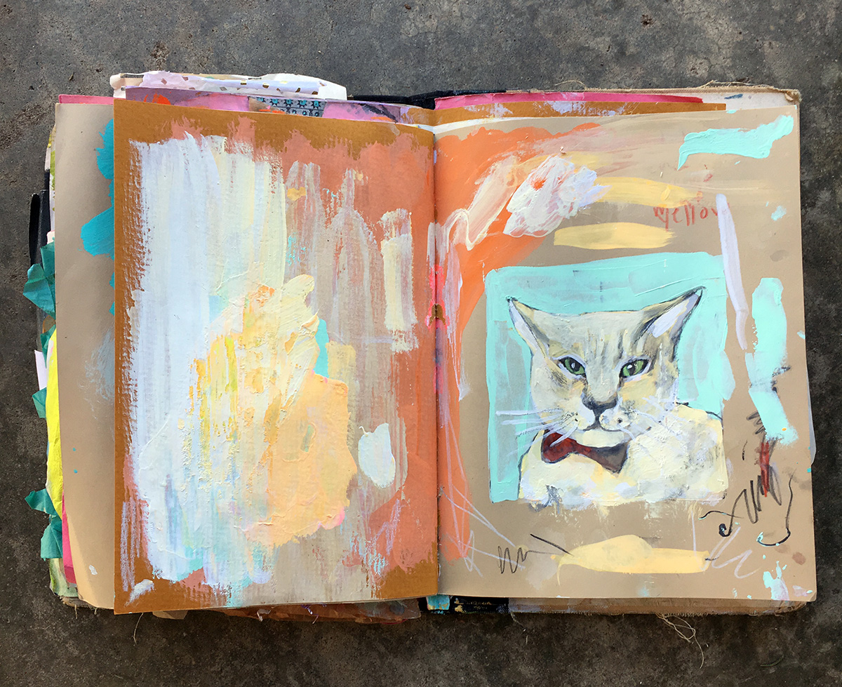 I worked on a cat portrait for my cousin, painted it into my sketchbook, then cut it out.