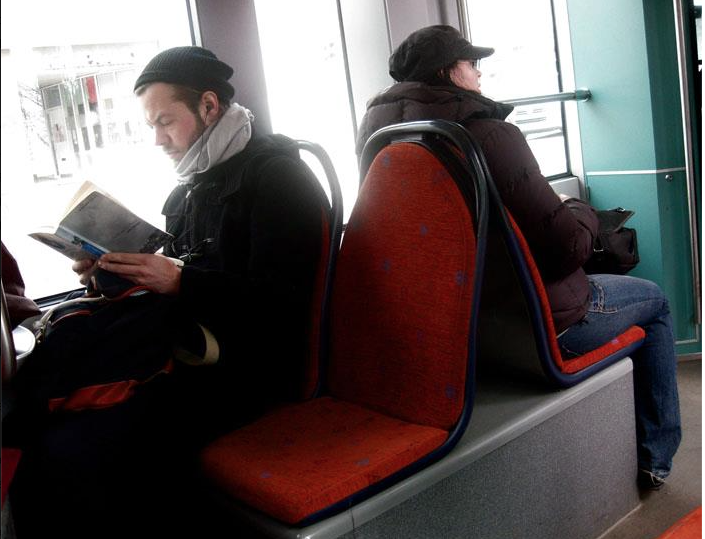Young Man on Helsinki Tram reading, The Shape of a Pocket by John Berger.