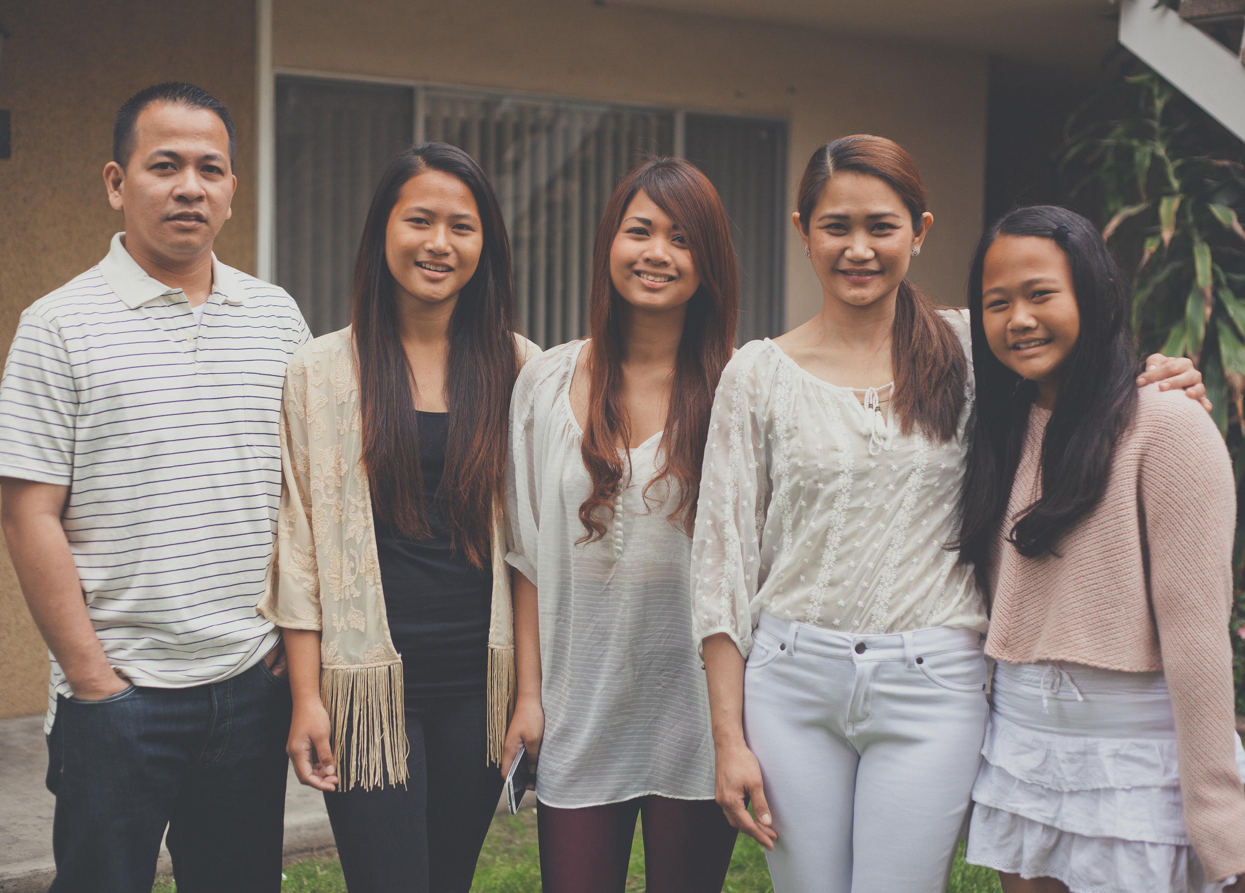 Meet Rita Garcia and family - My name is Rita. My family and I are from General Santos in the Philippines. We came to America for the opportunities—not only for us, but more for our daughters, Camille (17), Katrina (14), and Chloe (10). Like all parents, we want to give them the opportunities we didn't have, and we know that they will be able to make their dreams come true here in America.My daughters are really loving America.Camille is a high school senior and works part time in retail fashion. She would like to be a fashion designer one day. Apart from that, like a true Filipina, she enjoys singing and she regularly posts her renditions of pop songs on youtube, where she enjoys a huge following.Katrina, is a high school freshman and is a multiple varsity athlete, particularly volleyball. She is Top 5 at her school and would like to pursue a science degree in college. Katrina plays the guitar.Chloe is in fifth grade, and is a budding filmmaker who enjoys editing videos. She also loves reading Japanese manga comics and watching anime.We moved to the U.S. only three years ago and we now live in Central Los Angeles where there are many other Filipino families. We often still miss home and the rest of our friends and family back in the Philippines. But we are happy and satisfied with the life we have made here and we are excited to see what the future will bring.