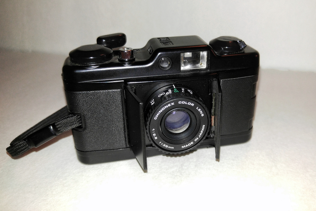 The Chinon Bellami with its lens cover open. Using the film advance lever to open it also turns on the camera so it's immediately ready to use.