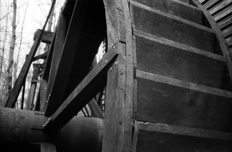 Closeup of the water wheel at the Grist Mill. The mill itself is authentic, although it was relocated here some years ago as a park feature. I really like how this shot came out.