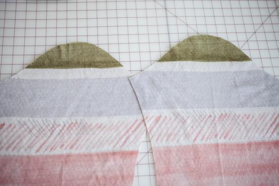 Asymmetric sleeve caps.