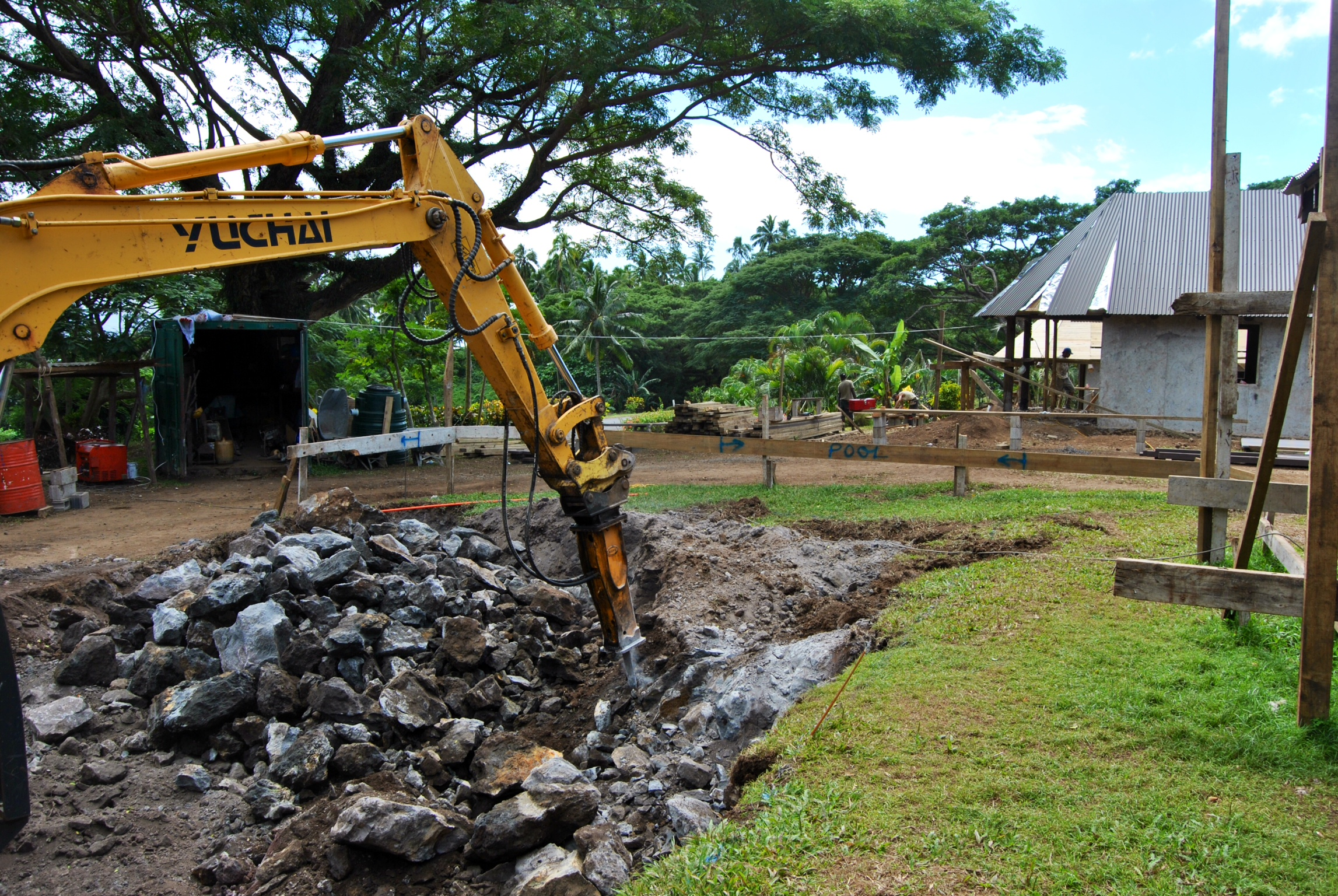 Oops! So, have you ever hit a lava tube during the installation of a swimming pool? Well we did, and all I can say is let's hear if for the yellow iron! I suspect the rubble will be put to good use.