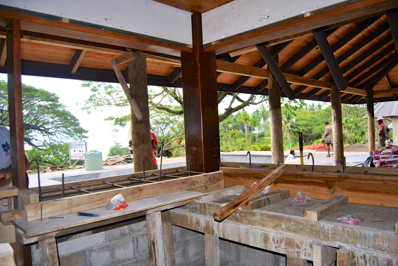 Here is the view looking towards the pool, and into the background, the Somosomo straits. They are starting to form up the bar so it can be poured, polished, and sealed. How do those wood finishes look?