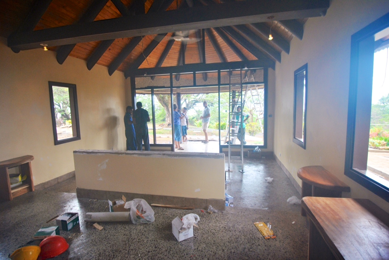 The construction crew has begun wiring the lighting and power throughout the bures. There are a couple neat things to notice in this picture. First, look at the floors! Also take a look at the locally harvested rain tree furniture.