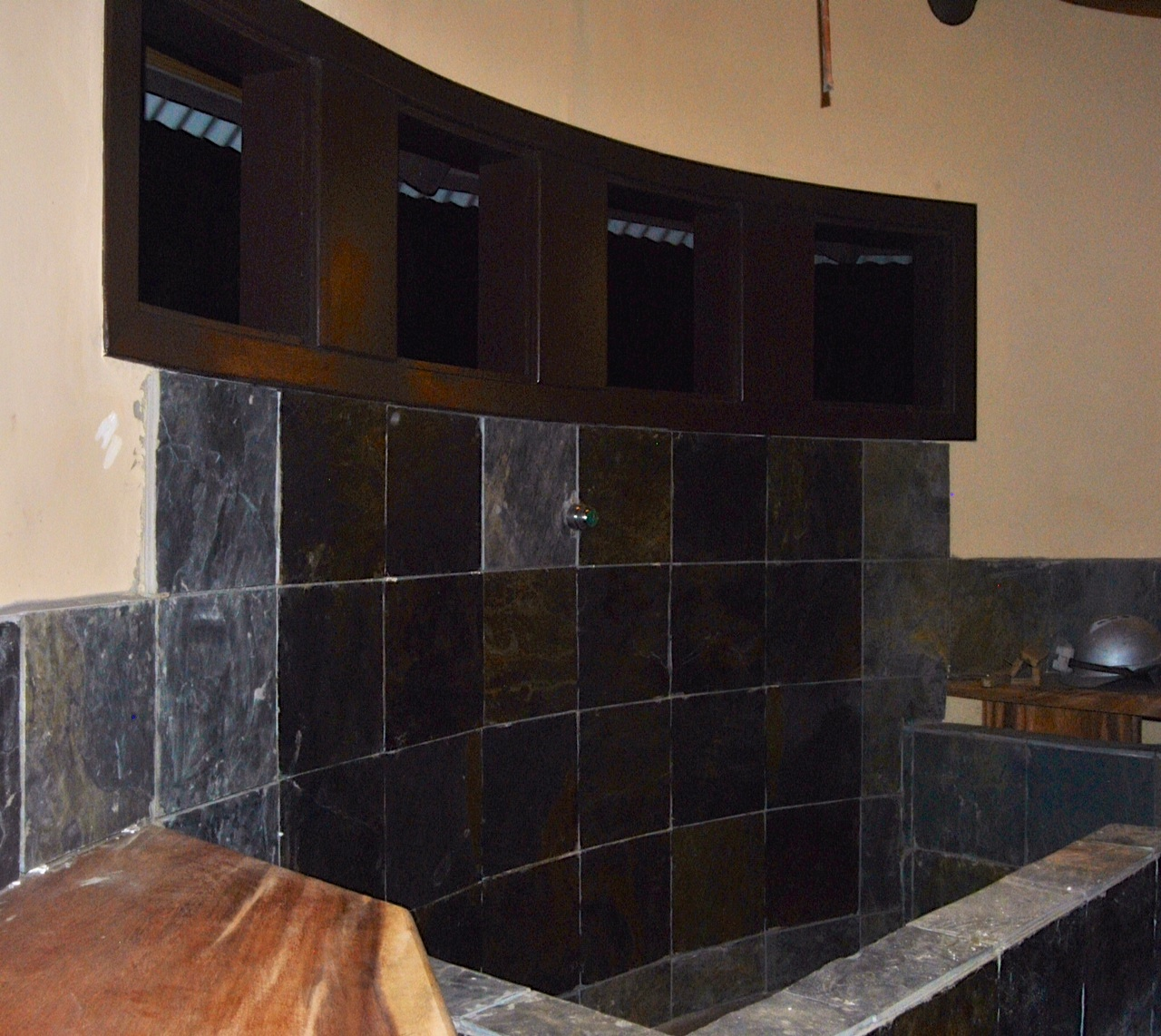 In the bathrooms, they are beginning to seal the tile in the showers. Love the contrast between the tile, walls, and wood!