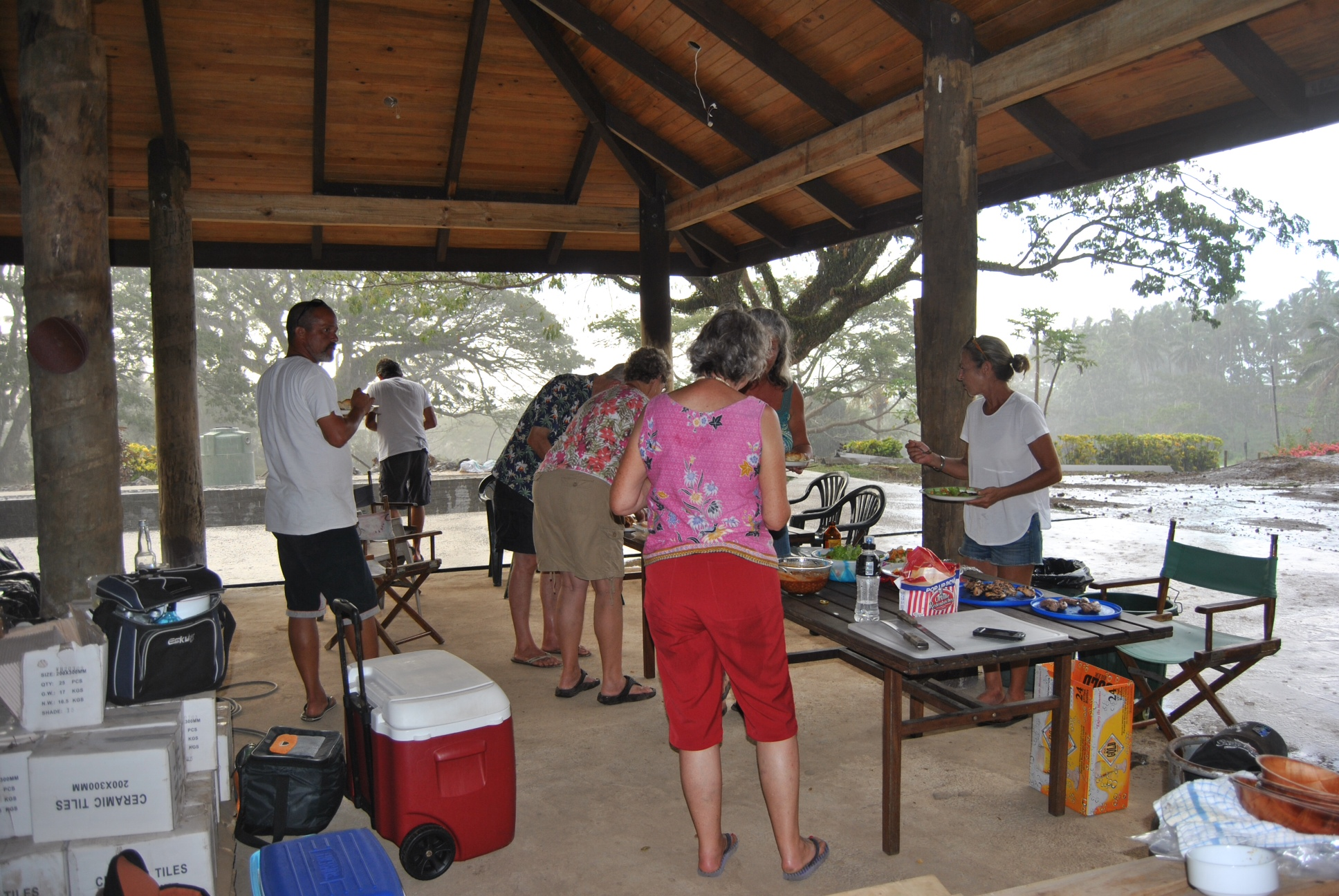 With the breaking of the drought by the slight misting of rain (by Taveuni standards), the residents felt it necessary to have a bbq at the Salty Fox. Note the boxes of ceramic tiles to be installed at theleft of the frame.