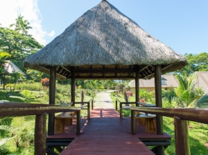 The bridge between two bures and the rest of the resort make a wonder place for a romantic dinner.