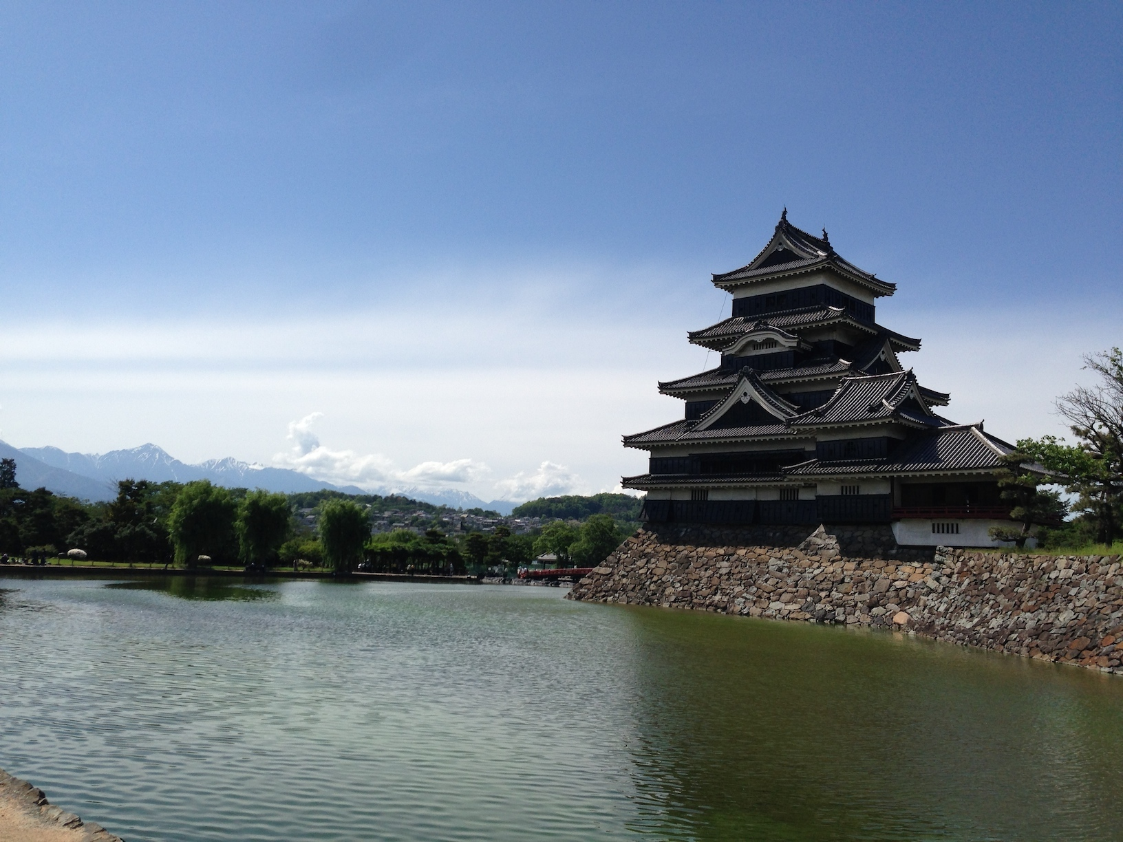 Matsumoto Castle with the Japanese Alps in the background.