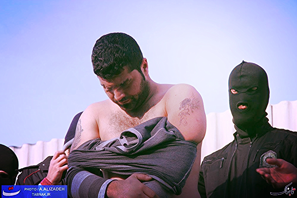 Iranian secret police publicly exposing the tattoos of a criminal. They do this to encourage the perception that crime and tattoos are inextricably linked.