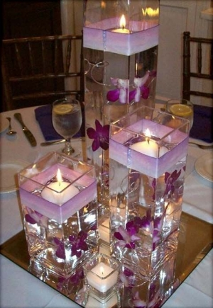 Beautiful DIY Flower and Candle Centerpieces.    Unique and gorgeous center pieces for your wedding table decor.