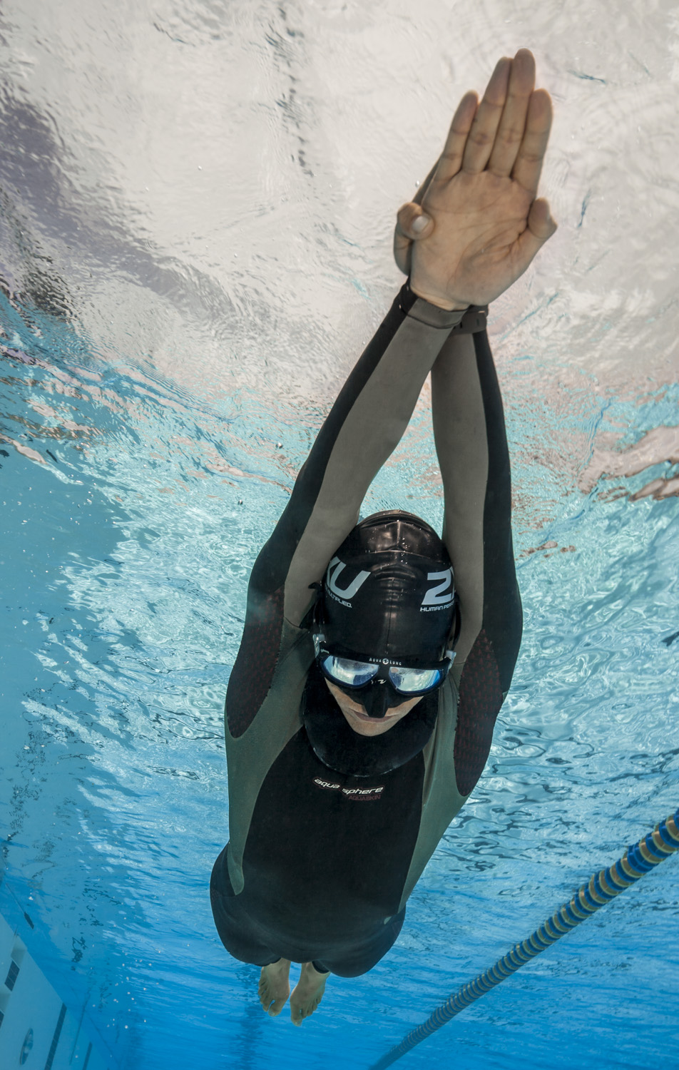 Freediver training in pool for dynamic with no fins.