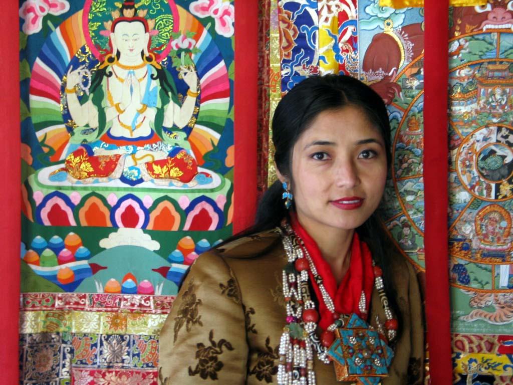 The Bride Ongmu in Prayer room with BuddhistTankah.jpg