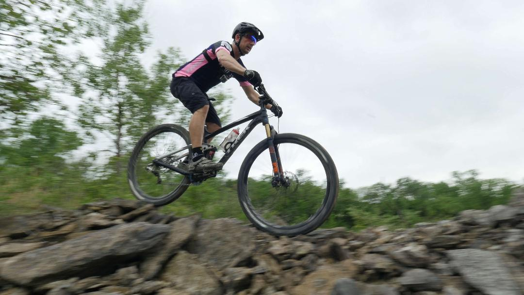 Mike riding rocks at quarry at the filming for the promo video.