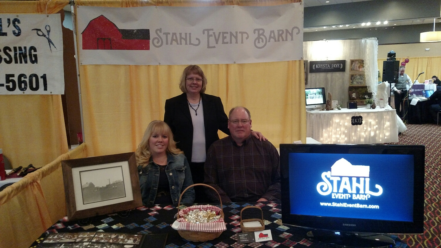 Julie, Ruth, and Ivan Stahl at the booth.
