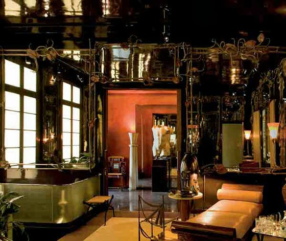 Paris Apartment of Yves Saint Laurent and Pierre Bergé featuring branches and leaf clad mirrors by Claude Lalanne. Image via Christie's.