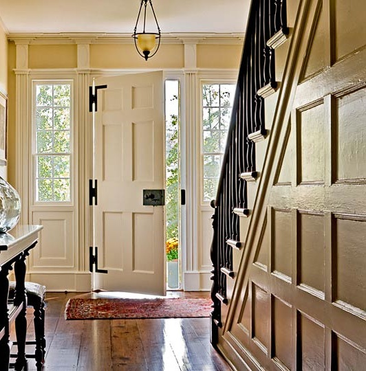 Front entry and hallway of a historic home expanded by Crisp Architects