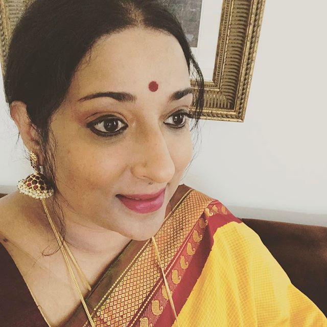 Heading out to the temple in one of my #Gadwal saris! I shelved this sari for nearly six years since I bought it thinking I made a mistake with the color but the bright yellow cotton paired with a lovely deep maroon and green silk border with silver gold zari is now one of my favorites! The #hemp #jumkas  I'm wearing are about 33 years old since my #dancing days!!! #saris #yellow #silk #jewelry #dance#indianfashion