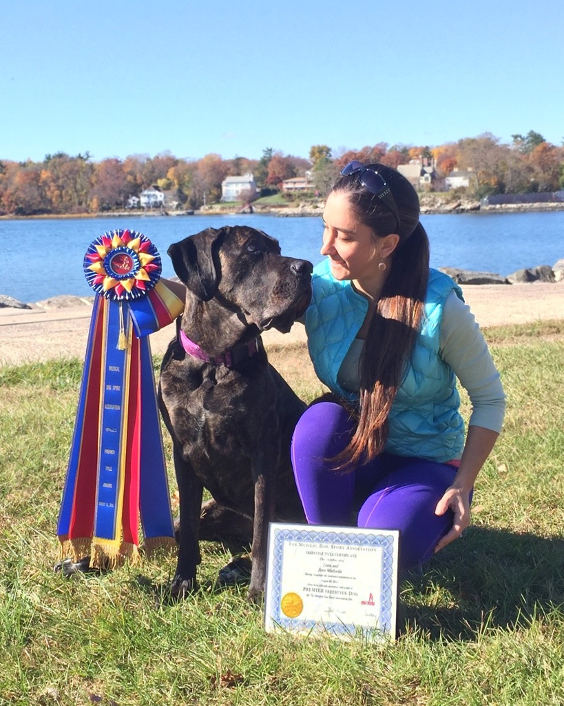 Terra and I with her Premier Title awards from the Musical Dog Sport Association.