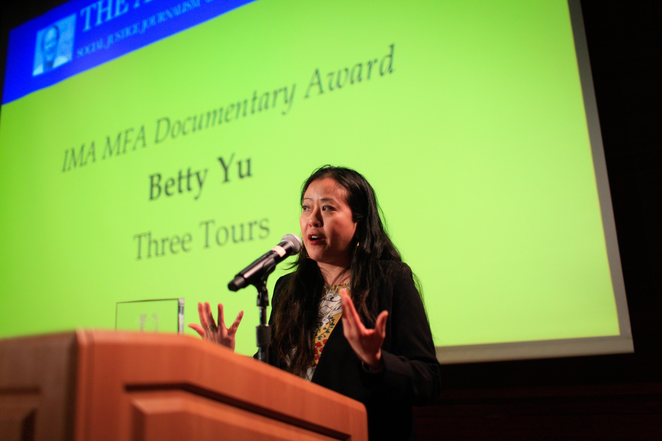 Aronson Awards-Betty at Podium Speaking.jpg