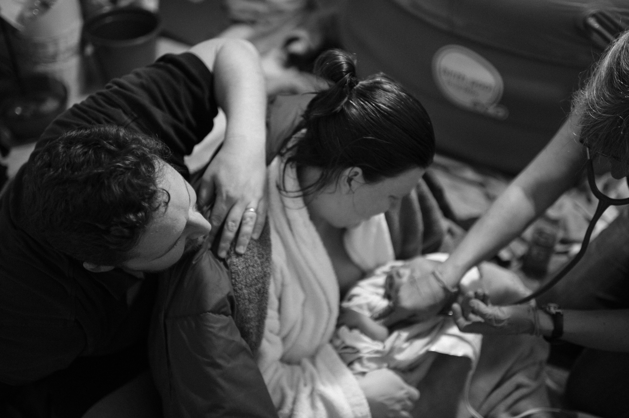 """As an experienced childbirth educator and birth doula, one of the things I consistently hear from the couples I work with is how they wished they had had more pictures (or any pictures!) taken during and directly after the birth of their baby. The birth of one's child is a day they will remember for the rest of their lives. My husband and I have used Isabel as our photographer for the birth of our son, and when I found out I was expecting again, Isabel was one of the first people I contacted since I knew I wanted her to document another birth for us. It was an absolute no brainer! I cherish these pictures. Labor is such a blur and whirlwind, and I loved being able to see the birth of my child from a different angle. All of my students and clients who've hired Isabel to photograph their births have been beyond thrilled with the quality of her work and her ability to """"fade into the background,"""" as one student put it, during the intimate moments of birth. I once showed a slideshow of Isabel's birth photos to a class of mine and there wasn't a single dry eye in the room. If you're on the fence about having your birth documented, don't be! You can only give birth to this baby once!"""