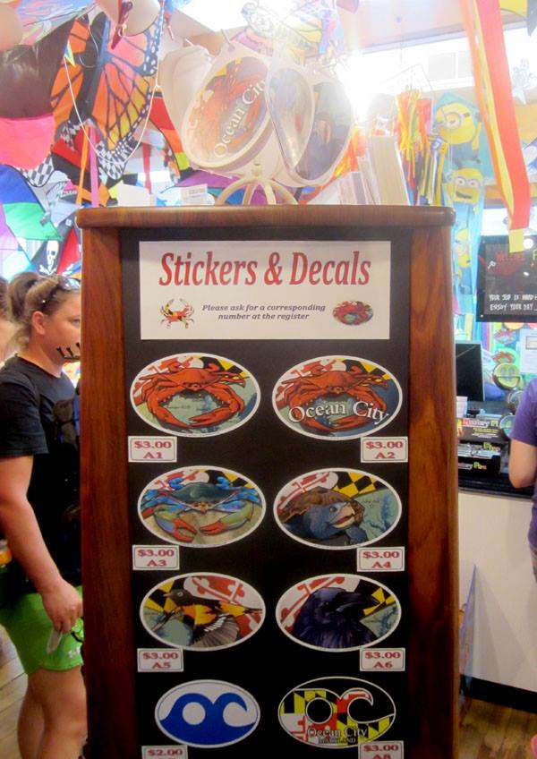 A large collection of our Citizen Pride stickers and magnets on display.