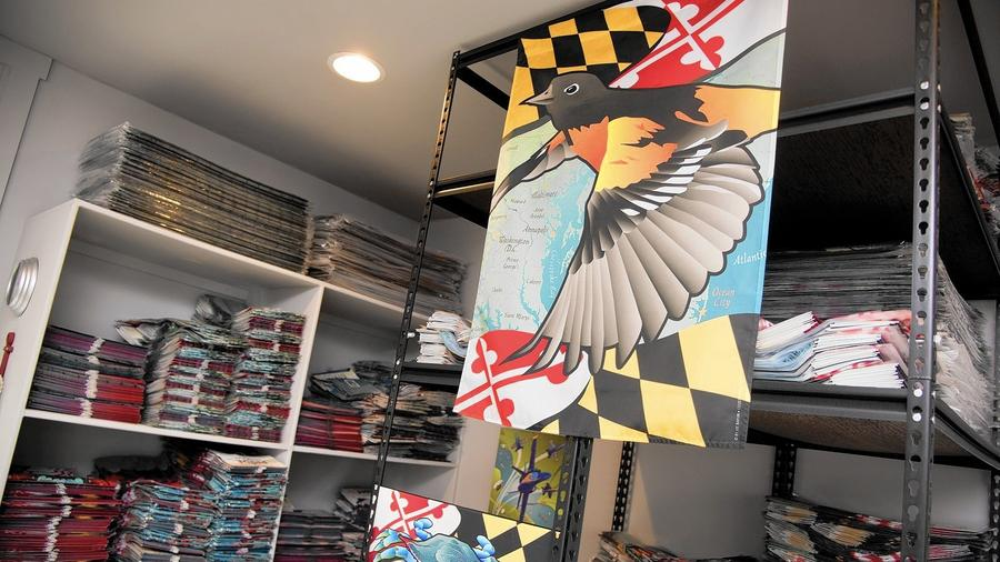 Citizen pride's storage room/FULFILLMENT centerwith theirmaryland oriole house flag on display. -- PHOTO BY JOSH MCKERROW.