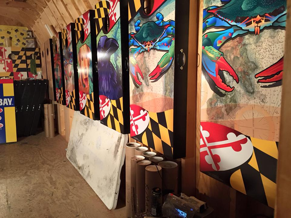 wall of citizen pride / South river cornhole boards hung with care