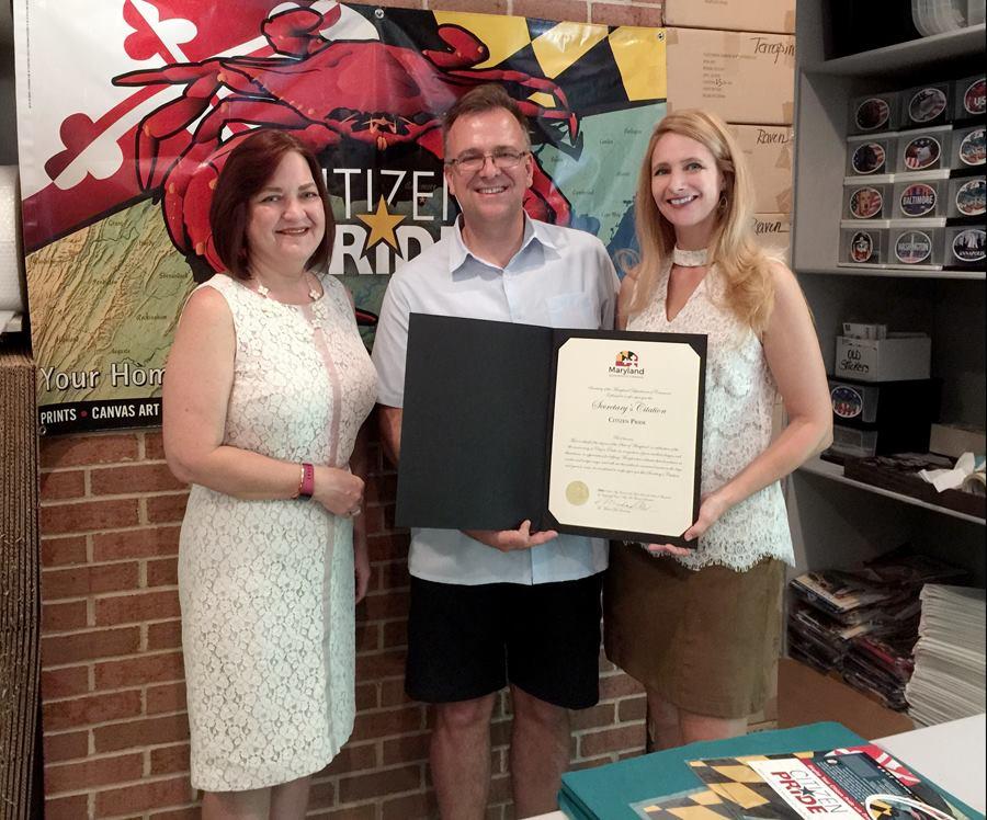 Lori A. Ratzburg of MD Dept. of Commerce with Joe and Eva Barsin of Citizen Pride.