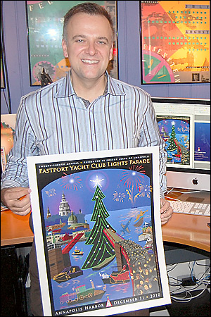 Joe Barsin, in his office, with the EYC Lights Parade poster.