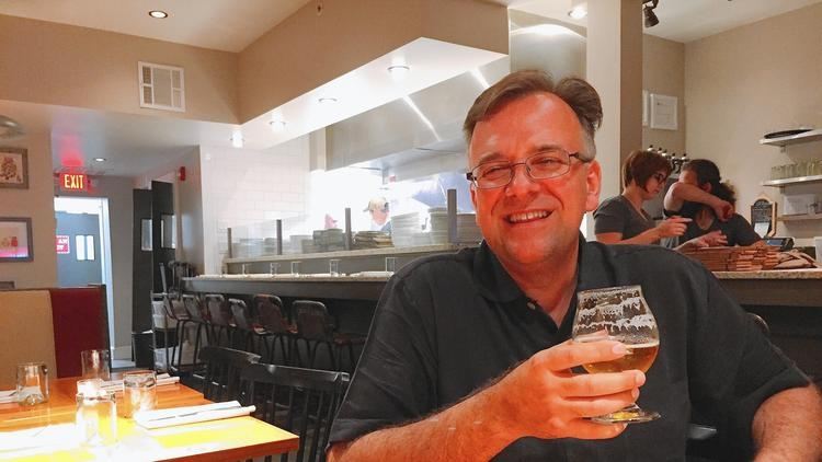 Joe Barsin enjoying a beer at Preserve in downtown Annapolis. He's half the creative force behind some of the best looking beer labels around. (photo: Liz Murphy / Corespondent)