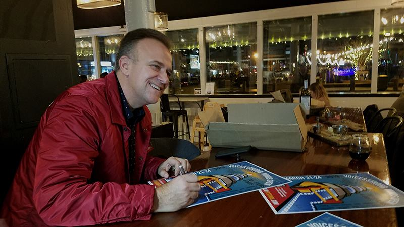 Joe Barsin signing the, limited edition, Annapolis Film Festival posters.