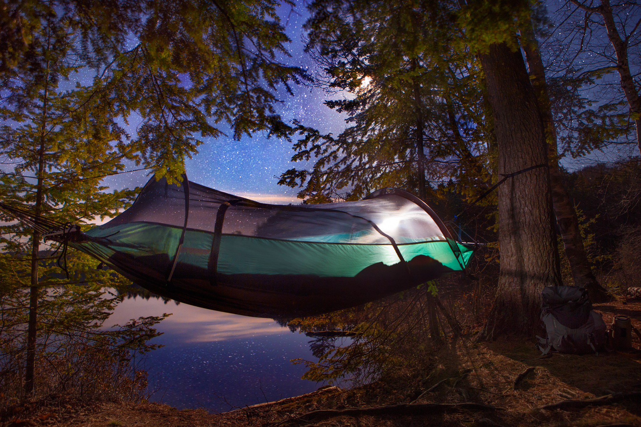 Lawson hammock set up under the moon and stars.
