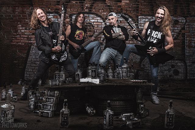My favorite shot of the guys from The Four Horsemen (Metallica tribute) over the Labor Day weekend! I arrived at the shoot Sean bringing me over to the back of his van. Removed a blanket to reveal over 50 bottles of Jack Daniels in containers. How they managed to drink 'em all before this shot? Living proof 'Alcoholica' is alive and well. Metallica would be proud. @metallica  #drinkemall #nikon #d750 #bandpromo #photoshoot #metallica #andjusticeforall #blackalbum #jameshedfield #kirkhammett #larsulrich #cliffburton #thefourhorsemen #tributeband #musicphotographer #cleveland #ohio #guitars #alcohol #tire #graffiti #brickwall #portraits #portraitphotography #portraiture