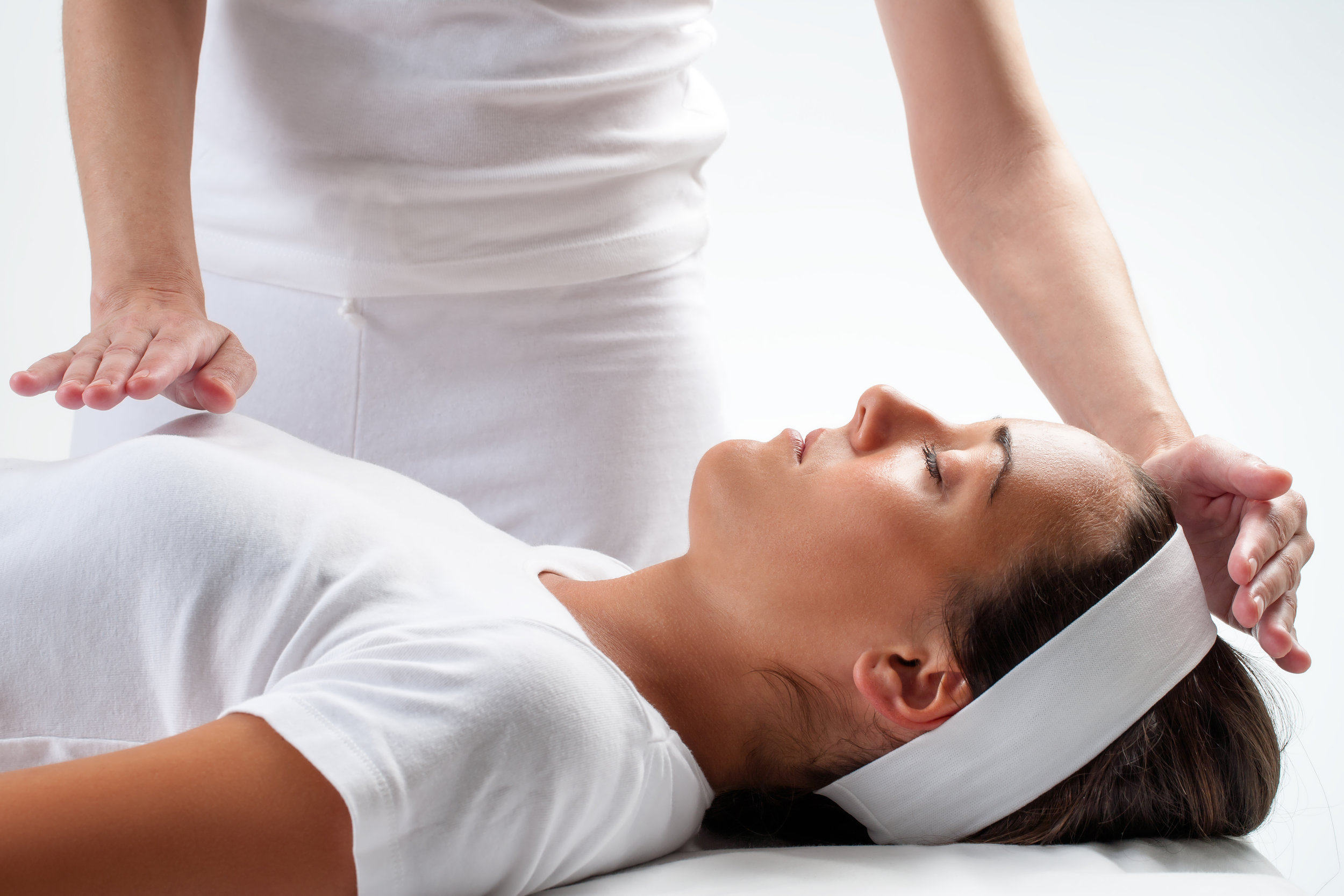 Woman at reiki session.