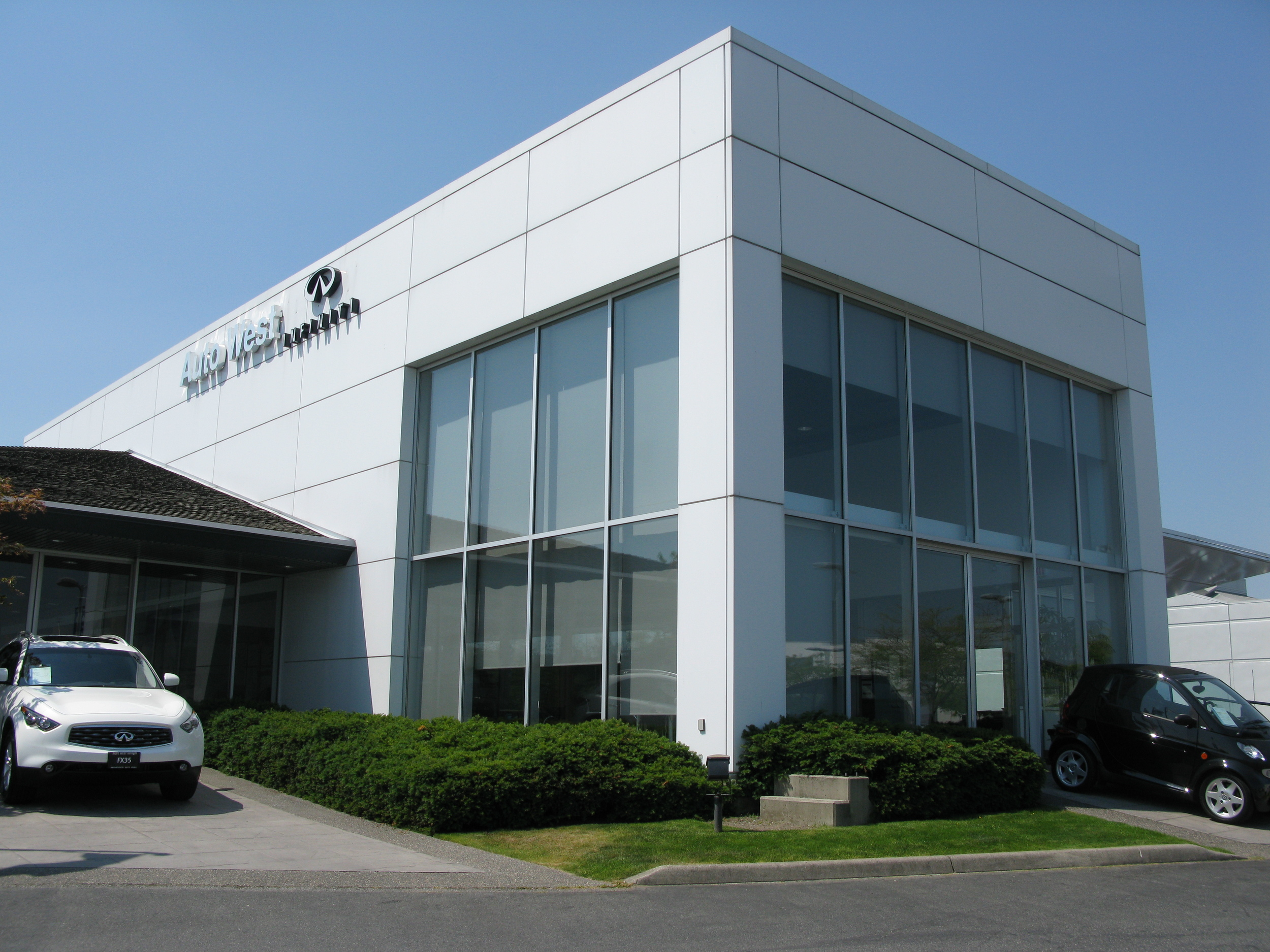 """""""Improve Existing Glazing  Performance""""  """"Reduce Operating Cost""""    Huper Optik Ceramic 30 applied to Auto West Infiniti Showroom in Richmond."""