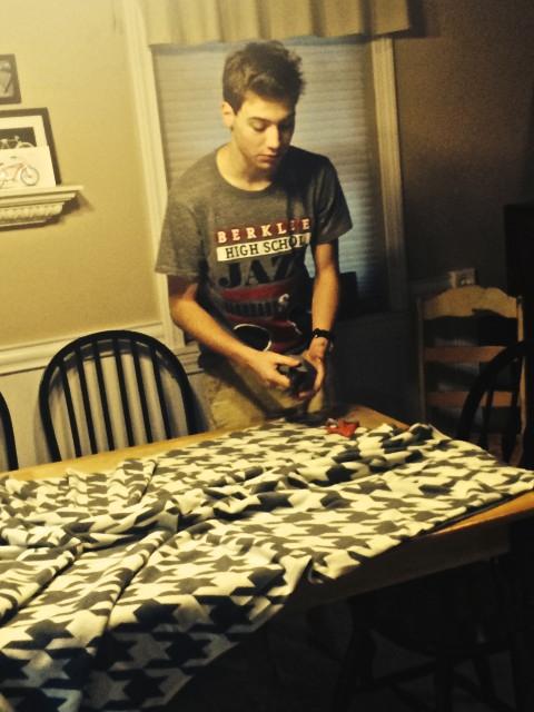 Cole making blankets for Hope Full RI
