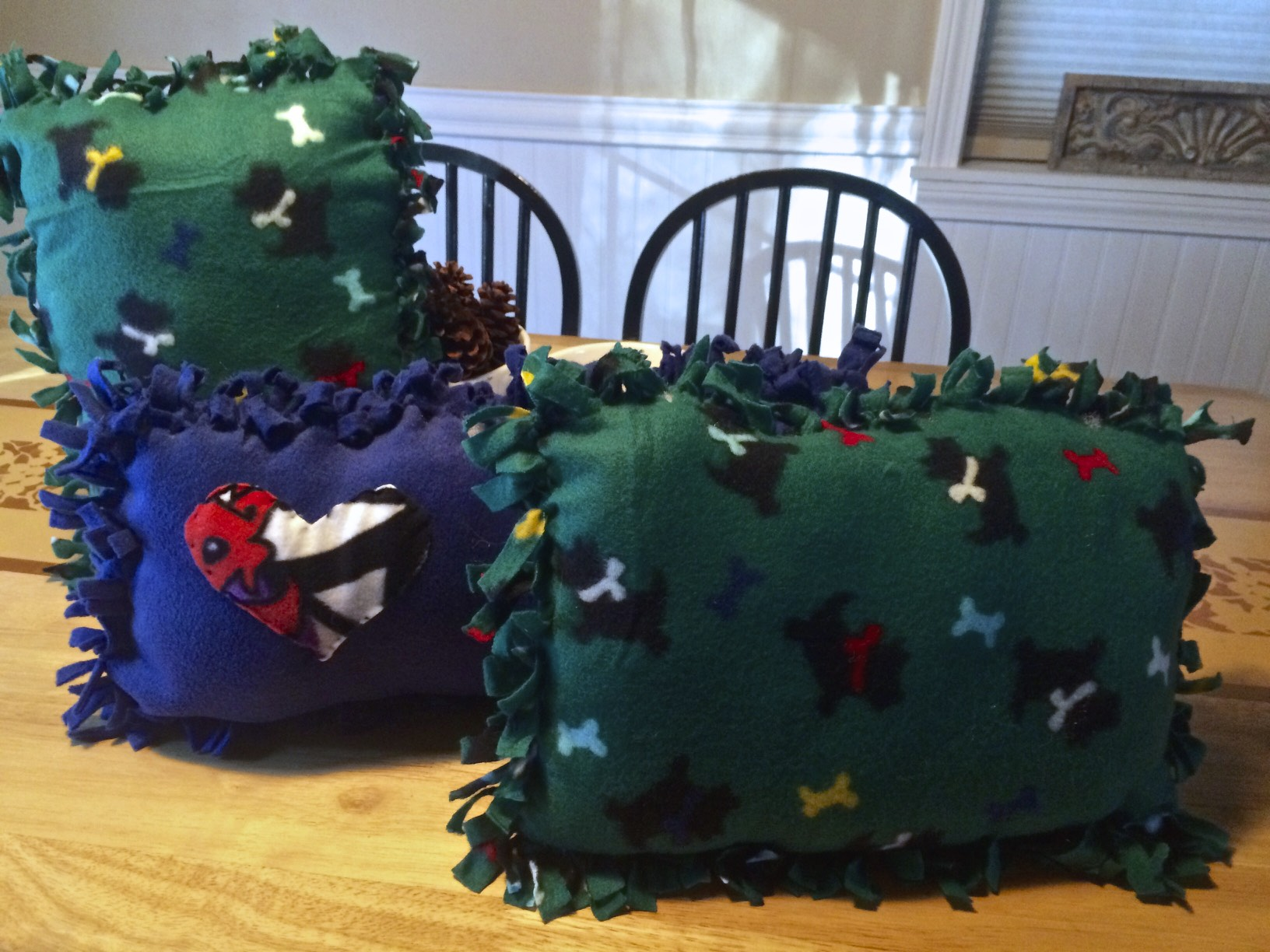 Super easy no sew pillows, all you need is fleece,scissors ( a good pair) and any kind of polyfill stuffing. Click on image and it will bring you to a how to. Its for pet beds but sizes can vary for pillows. Small throw pillow size is great.