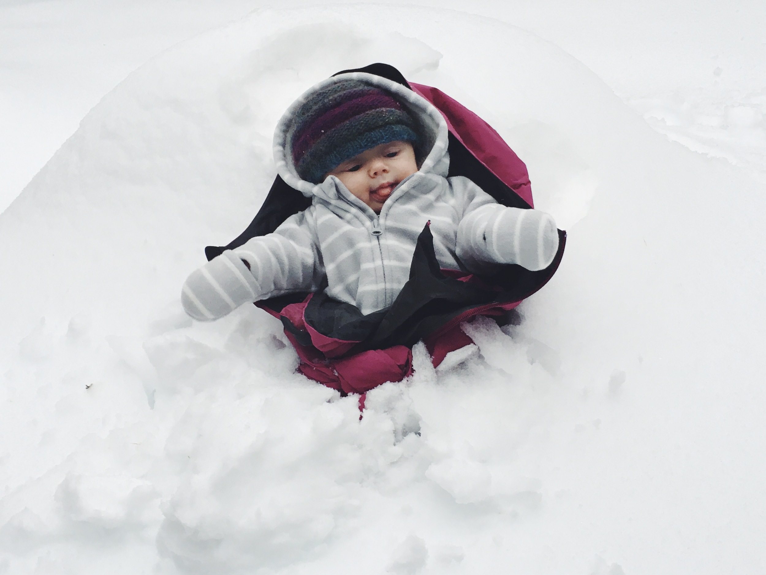 Playing in his first ever snow bank!