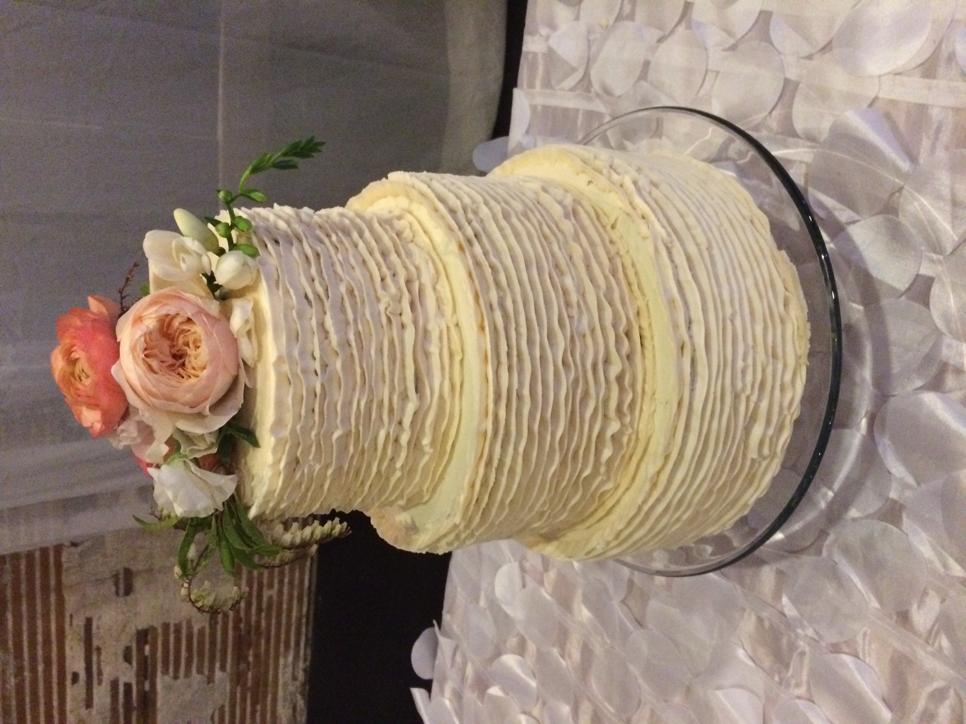 Vanilla bean wedding cake with buttercream ruffles