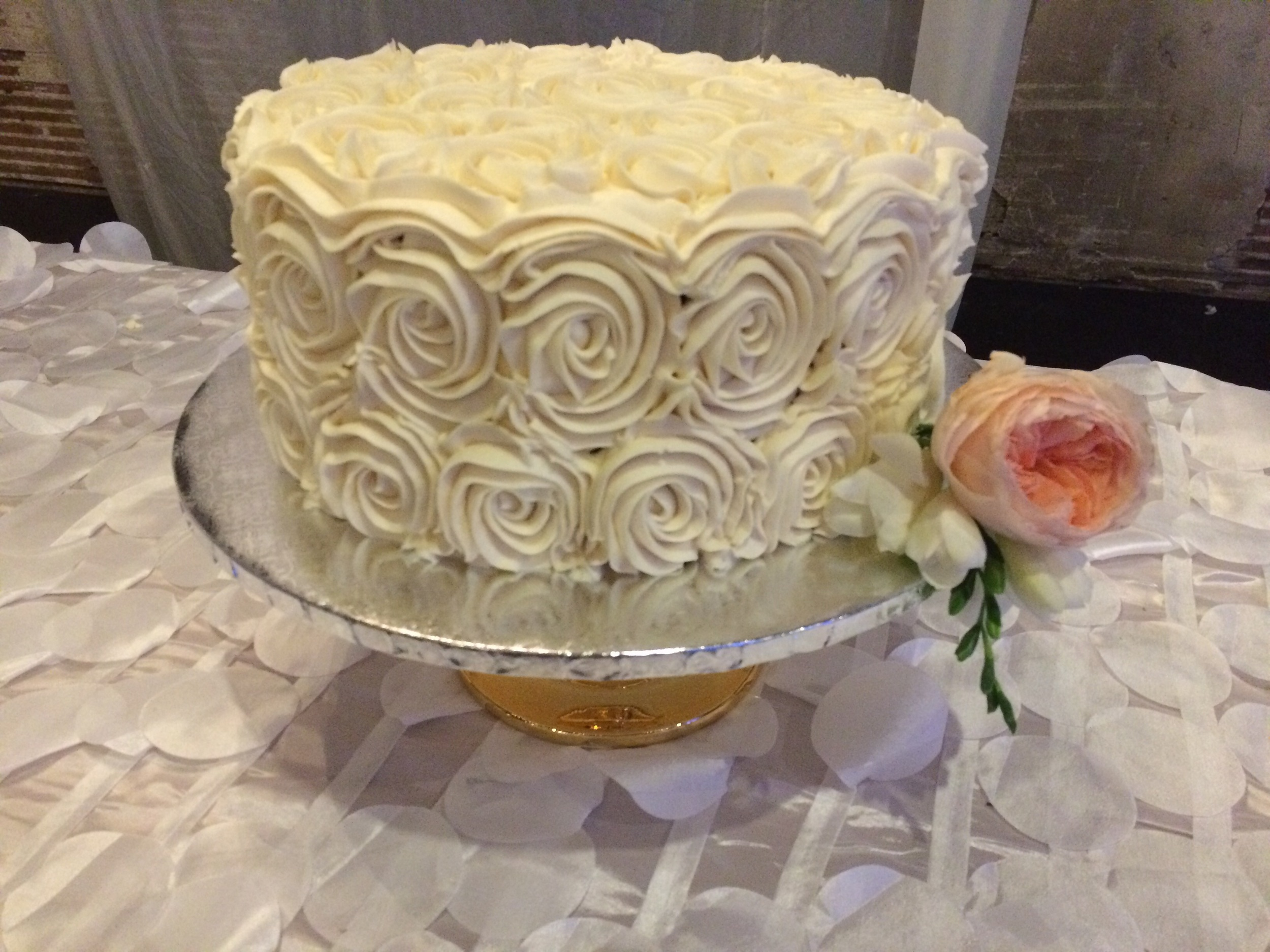 Chocolate cake filled with salted caramel and covered in buttercream roses