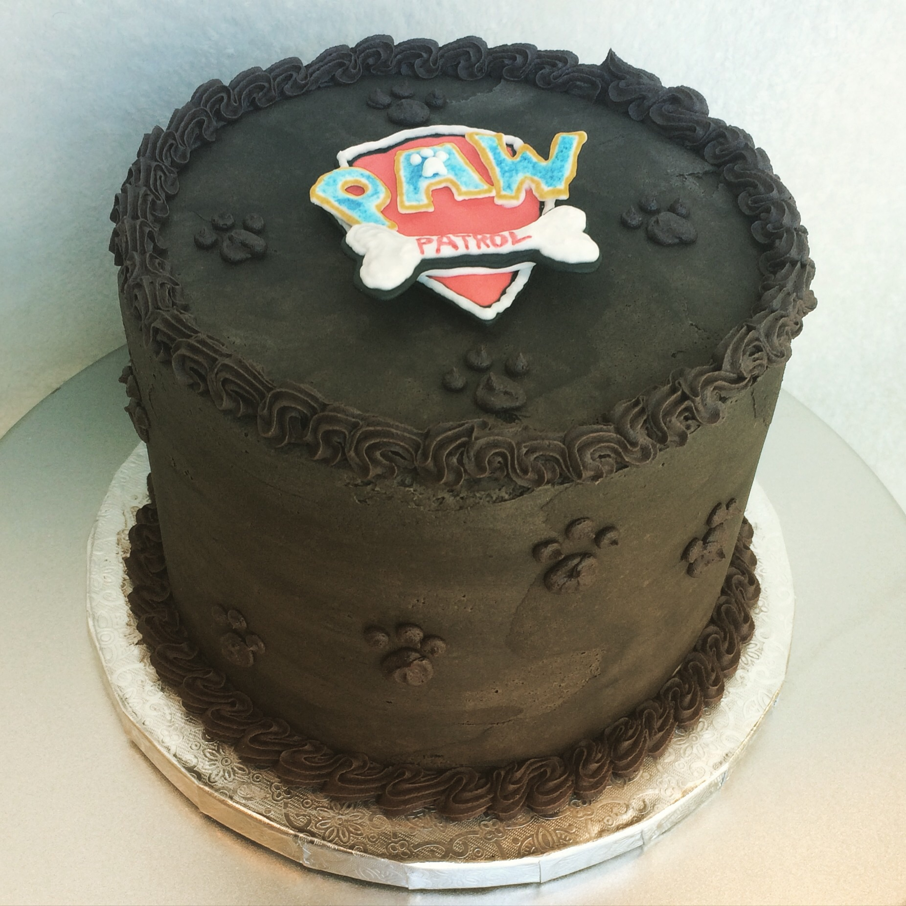 Paw Patrol birthday cake, chocolate cake topped with black cocoa buttercream