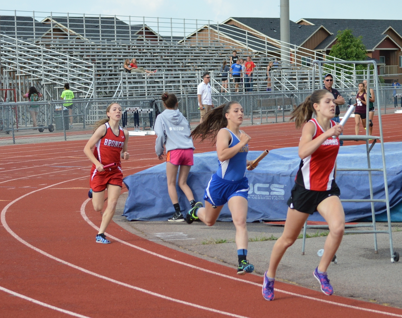 Madison Ward, St. George Academy, in the lead of the 4x400 relay.