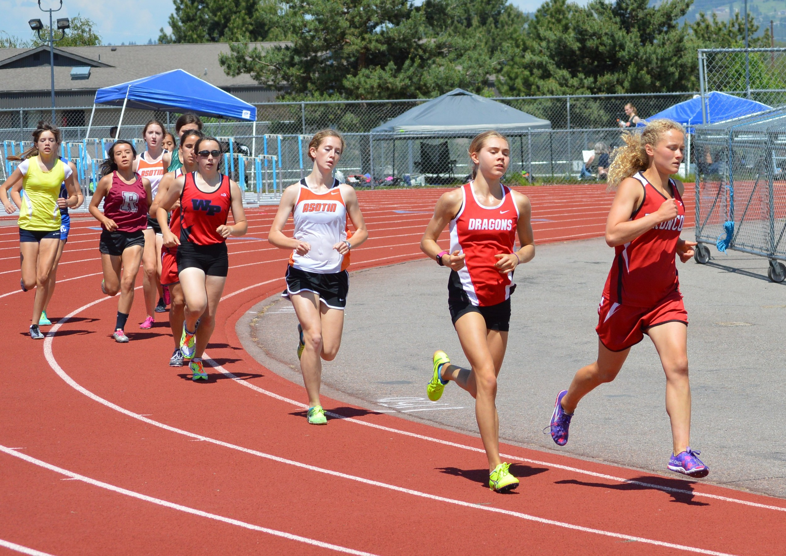 Tracy Melville of Lind-Ritzville leads the 3200M with Marika Morelan (St. George) challenging her. Lucy Eggleston holds a steady third with Waitsbury-Prescott's Emily Adams grabbing fourth.
