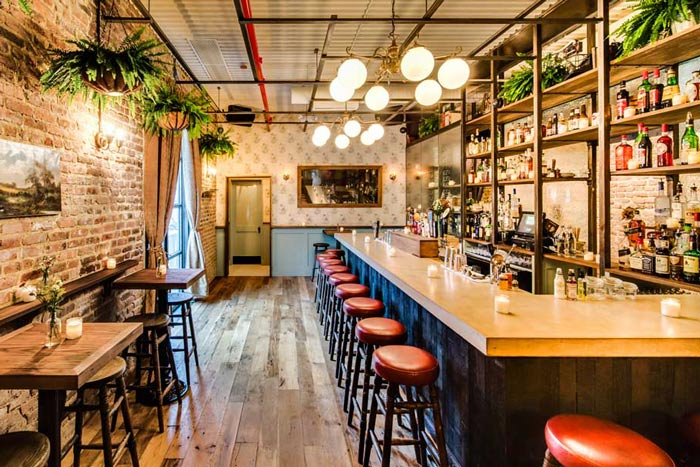 The Reclaimed Oak Flooring in this New York bar consists of old growth planks harvested from big trees long ago.  Heritage Oak  is pictured along with  Vinters Reserve Redwood  Wainscoting