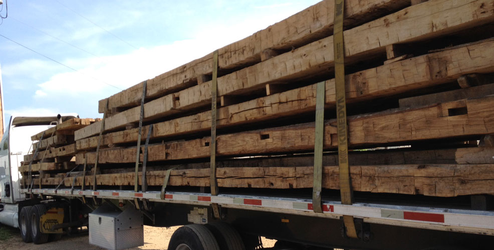 These large hand hewn reclaimed oak beams are rare and have more value than similar reclaimed wood lumber in smaller dimensions. Reclaimed beams can be graded for use in structural applications, too.
